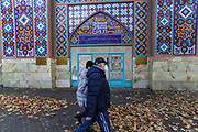People wearing face protective masks to curb the spread of coronavirus outbreak walks outside the Blue Mosque, which is the 18th-century Shia mosque in Yerevan, Armenia on Friday, Jan 15, 2021. This building was commissioned by Huseyn Ali Khan, the khan of Erivan and it is one of the oldest extant structures in central Yerevan and the most significant structure from the city's Iranian period. (Photo/ Vudi Xhymshiti)