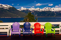 A row of colorful garden chairs, Haines, Alaska USA.