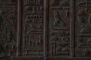 Close up of hieroglyphics on an interior wall of the Temple of Horus, Edfu, Egypt