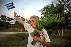 November 30, 2016 - Cuba - Eugenia Migalina Ramos Cobos, 72, waits for the passage of Fidel Castro's ashes outside of Ranchuelo, Cuba on Wednesday, November 30, 2016. (Credit Image: © Al Diaz/TNS via ZUMA Wire)