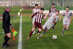 Davor Bubonja #33 of NK Triglav and Mitja Resek #30, Marko Drevensek #17 of Aluminij during football match between NK Triglav and Aluminij in 16th Round of PrvaLiga NZS 2012/13 on November 25, 2012 in Kranj, Slovenia. (Photo By Grega Valancic / Sportida)