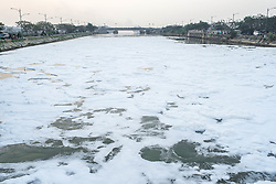 July 23, 2017 - Jakarta, Indonesia - Polluted toxic white foam flow along Jakarta East Flood Canal to Jakarta Bay, Indonesia, on July 23, 2017. This water pollution expected comes from home waste. (Credit Image: © Anton Raharjo/NurPhoto via ZUMA Press)