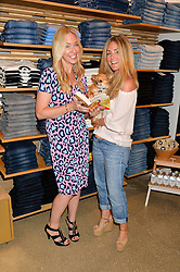Left to right, ROSIE NIXON and DONNA IDA with her dog Fernando at a party to celebrate the paperback lauch of The Stylist by Rosie Nixon hosted by Donna Ida at her store at 106 Draycott Avenue, London on 17th August 2016.