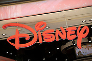 Sign for the media brand Disney Store in Birmingham, United Kingdom. The Walt Disney Company, commonly known as Walt Disney or simply Disney, is an American diversified multinational mass media and entertainment conglomerate.