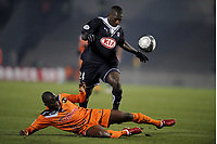 FOOTBALL - FRENCH CHAMPIONSHIP 2009/2010  - L1 - GIRONDINS BORDEAUX v FC LORIENT - 19/12/2009 - PHOTO JEAN MARIE HERVIO / DPPI - ABDOU TRAORE (BDX) / SIGAMARY DIARRA (LOR)