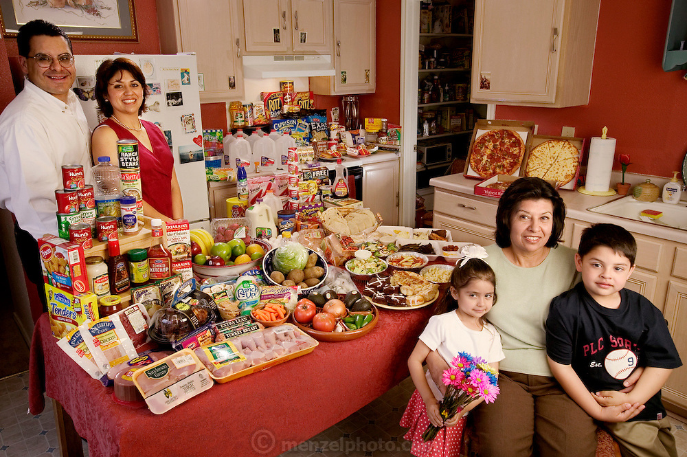The Fernandez family in the kitchen of their San Antonio, Texas home with a week's worth of food. Lawrence, 31, and wife Diana, 35, standing, and Diana's mother, Alejandrina Cepeda, 58, sitting with her grandchildren Brian, 5, and Brianna, 4. From the book Hungry Planet: What the World Eats (Model Released)