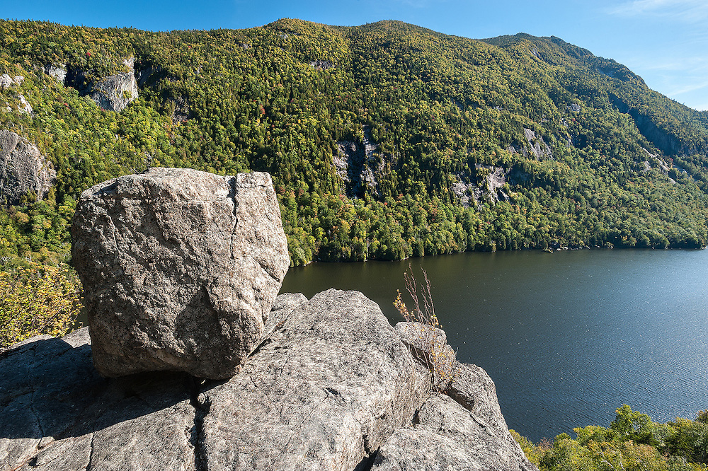 Lower Ausable Lake, Adirondacks, NY.<br />      Late afternoon on the scenic trail to, or in this case, from Sawteeth.  At the first outlook, a large erratic has surveyed this view for eons, a couple of hundred feet above the lake.  Across the water, two high peaks, Colvin and Blake, dominate the skyline.