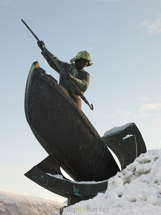 Statue of a whaler near the dock in Tromso, Norway