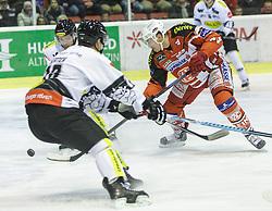14.12.2014, Stadthalle, Klagenfurt, AUT, EBEL, EC KAC vs Dornbirner Eishockey Club, 27. Runde, im Bild Andy Sertich (Dornbirner Eishockey Club, #10), Jamie Lundmark (EC KAC, #74) // during the Erste Bank Icehockey League 27th round match betweeen EC KAC and Dornbirner Eishockey Club at the City Hall in Klagenfurt, Austria on 2014/12/14. EXPA Pictures © 2014, PhotoCredit: EXPA/ Gert Steinthaler