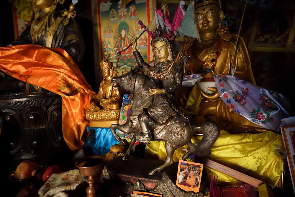 A statue of Kawagarbo/Meili on horseback, the Meditation cave of Padmasambhava, enroute to the waterfall near Yubeng, Meili Snow Mountain National park, Yunnan, China
