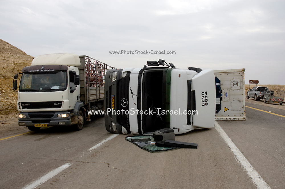 Israel, Judea Desert, Sdom, an overturned semitrailer Mercedes truck on the narrow winding slopes leading from the Dead Sea to Dimona