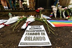 © Licensed to London News Pictures. 13/06/2016. London's gay village light candles in St Anne's church to honour victims of Pulse shooting in the United States.  It is alleged that The gunman, Omar Mateen killed at least 50 people in Pulse nightclub in Floriday, USA.  London, UK. Photo credit: Ray Tang/LNP