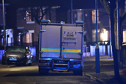 © Licensed to London News Pictures. 28/02/2021. Ashton-under-Lyne, UK. Police and the Royal Logistical Corps bomb squad respond to a suspicious device found at a premesis on Connery Crescent, earlier this evening . Photo credit: Joel Goodman/LNP