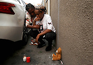 """Dakota Northington, left, points to the area on Dani O'Neal where their 16-year-old relative, Aaron Pryor, was fatally shot on Sunday as they remember their loved one on Thursday, October 1, 2020, in Oakland, Calif. The Skyline High School football player was killed in a driveway near the 5800 block of Elizabeth Street in the Melrose neighborhood. """"He was only 16 for 25 days,"""" O'Neal said. """"Aaron was a good kid."""""""