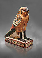 Ancient Egyptian wooden falcon bird, Late Period (722-322 BC), Egyptian Museum, Turin. Cat 986. Grey background. <br /> <br /> Wooden tomb models were an Egyptian funerary custom from the Middle Kingdom in which wooden figurines and sets were constructed to be placed in the tombs of Egyptian royalty. These wooden models represented the work of servants, farmers, other skilled craftsman, armies, and religious rituals .<br /> <br /> If you prefer to buy from our ALAMY PHOTO LIBRARY  Collection visit : https://www.alamy.com/portfolio/paul-williams-funkystock/ancient-egyptian-art-artefacts.html  . Type -   Turin   - into the LOWER SEARCH WITHIN GALLERY box. Refine search by adding background colour, subject etc<br /> <br /> Visit our ANCIENT WORLD PHOTO COLLECTIONS for more photos to download or buy as wall art prints https://funkystock.photoshelter.com/gallery-collection/Ancient-World-Art-Antiquities-Historic-Sites-Pictures-Images-of/C00006u26yqSkDOM