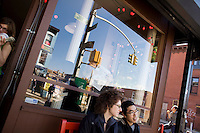 """7 Novembre, 2008. Brooklyn, New York.<br /> <br /> Dei ragazzi siedono davanti all'entrata della caffetteria Gorilla Coffee Inc., nella Fifth Avenue a Park Slope, Brookyln, New York. Park Slope, spesso definito dai newyorkesi come """"The Slope"""", è un quartiere nella zona ovest di Brooklyn, New York, e confinante con Prospect Park.  Park Slope è un quartiere benestante che ha il maggior numero di nascite, la qualità della vita più alta e principalmente abitato da una classe media di razza bianca. Per questi motivi molte giovani coppie e famiglie decidono di trasferirsi dalle altre municipalità di New York a Park Slope. Dal punto di vista architettonico, il quartiere è caratterizzato dai brownstones, un tipo di costruzione molto frequente a New York, e da Prospect Park.<br /> <br /> ©2008 Gianni Cipriano for The New York Times<br /> cell. +1 646 465 2168 (USA)<br /> cell. +1 328 567 7923 (Italy)<br /> gianni@giannicipriano.com<br /> www.giannicipriano.com"""