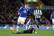 Ross Barkley of Everton is tackled by Henri Saivet of Newcastle United. Barclays Premier League match, Everton v Newcastle United at Goodison Park in Liverpool on Wednesday 3rd February 2016.<br /> pic by Chris Stading, Andrew Orchard sports photography.