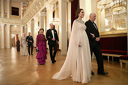 Duchess of Cambridge is escorted into dinner by King Harald V of Norway and the Duke of Cambridge is escorted by Queen Sonja of Norway into dinner at the Royal Palace, Oslo, Norway at the end of the third day of her tour of Scandinavia.
