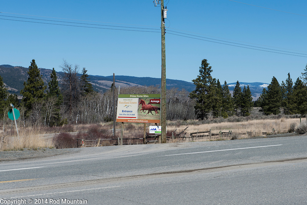 A new developement sign advertises homes for sale in the Okanagan.