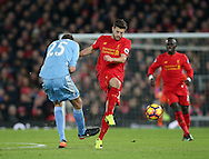 Liverpool's Adam Lallana tussles with Stoke's Peter Crouch during the Premier League match at Anfield Stadium, Liverpool. Picture date December 27th, 2016 Pic David Klein/Sportimage