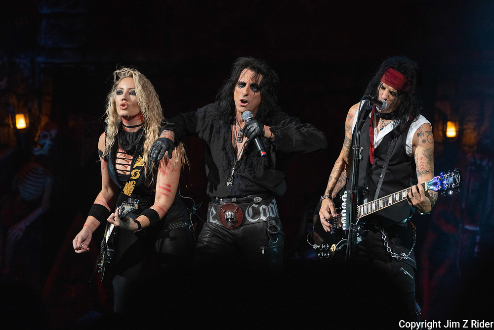 After nearly 19 months off stage, Rock and Roll legend ALICE COOPER, 73, launches his fall 2021 tour at Ocean Casino Resort in Atlantic City, New Jersey.  NITA STRAUSS (left), vocals and guitar, and TOMMY HENRIKSEN join COOPER.