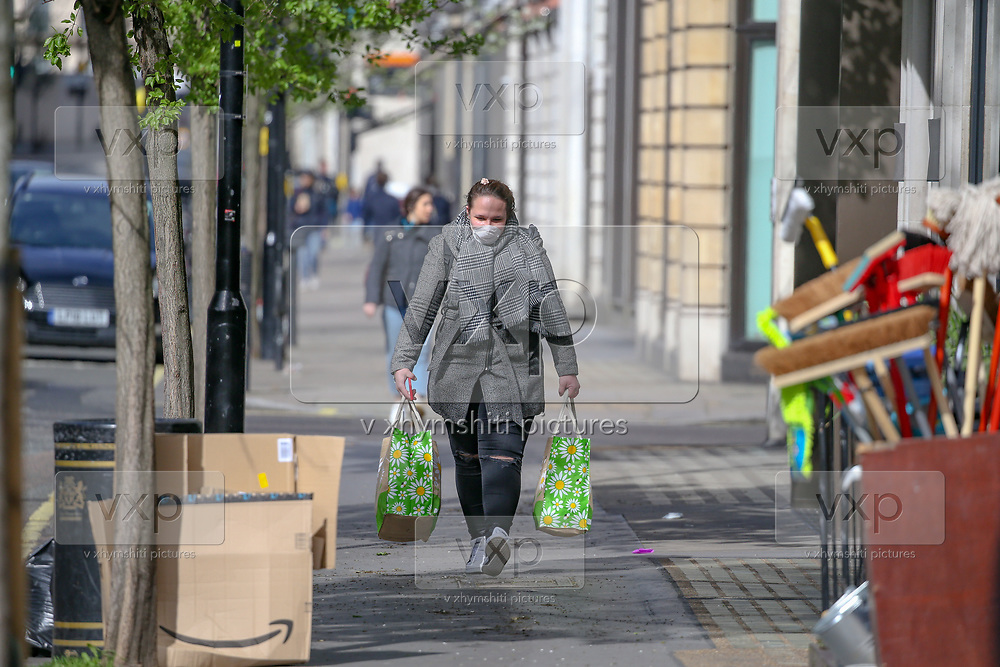 Woman wearing face masks walk in central London, Saturday, March 21, 2020. For most people, the new coronavirus causes only mild or moderate symptoms, such as fever and cough. For some, especially older adults and people with existing health problems, it can cause more severe illness, including pneumonia. (Photo/Vudi Xhymshiti)