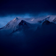 Peaks of the lower Gangotri peek through the clouds of a late-monsoon storm; Garhwal Himalaya, Uttarkhand, India.
