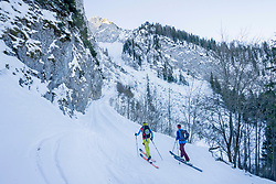 Men skiing on snow slope