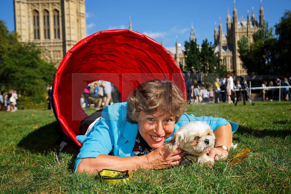 © Licensed to London News Pictures. 08/09/2016. London, UK. REBECCA POW MP performs with her rescue dog 'Daisy' whilst taking part in Westminster Dog of the Year competition in Victoria Tower Gardens, London on Thursday, 8 September 2016. Photo credit: Tolga Akmen/LNP