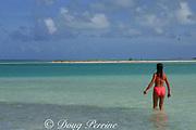 visitor wades into lagoon, Christmas Island ( Kiritimati ), Republic of Kiribati, northern Line Islands, equatorial Central Pacific Ocean, MR 299