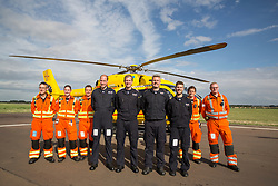 The Duke of Cambridge Poses for a final photo with both day and night shift crews as he starts his final shift with the East Anglian Air Ambulance based at Marshall Airport near Cambridge. (left to right) CCP Gary spitzer, Dr Karen rhodes, Dr Adam Chesters, Prince William, Cpt Matt Sandbach, Cpt Dave Kelly, Pilot Olly Gates, Dr Tobias Gouse and CcpCarl Smith .