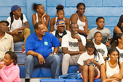 """Milt Newton watches """"Jah Souljahs"""" take on the """"Roaring Lions""""  during the first game of the Summer Classic.  Milton M. Newton Summer Classic Basketball Single Elimination 13-16 CoEd Tournament at the Charlotte Amalie High School Gymnasium.  St. Thomas, USVI.  8 August 2016.  © Aisha-Zakiya Boyd"""