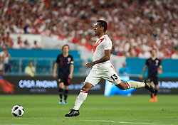 March 23, 2018 - Miami Gardens, Florida, USA - Peru defender Renato Tapia (13) in action during a FIFA World Cup 2018 preparation match between the Peru National Soccer Team and the Croatia National Soccer Team at the Hard Rock Stadium in Miami Gardens, Florida. (Credit Image: © Mario Houben via ZUMA Wire)