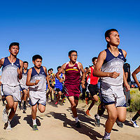 Racers maneuver into position early on the course during the boys varsity race of the Tohatchi Cross Country meet in Tohatchi Friday.