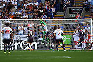 Derby County Goalkeeper Scott Carson punches the ball clear of danger. Skybet football league championship match, Bolton Wanderers v Derby County at the Macron stadium in Bolton, Lancs on Saturday 8th August 2015.<br /> pic by Chris Stading, Andrew Orchard sports photography.