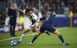 November 27, 2018 - Turin, Italy - Joao Cancelo of Juventus (L) disputes the ball with Gonzalo Guedes of Valencia during the UEFA Champions League match between Juventus and Valencia CF at Allianz Juventus Stadium  in Turin, Italy on November 27, 2018  (Credit Image: © Jose Breton/NurPhoto via ZUMA Press)