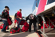 The Iraan High School football team loads their gear onto busses for their trip to Arlington for the state title game in Iraan, Texas on December 14, 2016. (Cooper Neill for The New York Times)