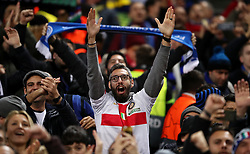 An Inter Milan fan in the stands shows his support