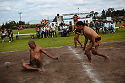 SAN MARTIN DE LAS PIRAMIDES, MEXICO - APRIL 15, 2017: Coaches of Mesoamerican Ball Game titled Ulamaztli during a friendly competition during a tournament in San Martin de las Piramides, Estado de Mexico. A player prepares himself to receive and hit a rubber ball during a tourney of Mesoamerican Ball Game titled Ulamaztli. To withstand the blow of the ball, that weighs 7 pounds, the players protect their hips with bandages and leather belts. Each team has 5 players and the game purpose is to keep the ball inside the play area without touch it with hands or another part of the body, except the hips. Rodrigo Cruz for The New York Times