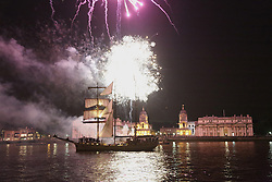 © Licensed to London News Pictures. 28/08/2013. Fireworks illuminate the night sky at Greenwich with the Old Royal Naval College behind and a tall ship sailing past. The fireworks were launched on the river as part of the Sail Royal Greenwich tall ships event. credit : Rob Powell/LNP