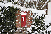 Snow scene with a red post box in the Herefordshire countryside near Clifford, England, United Kingdom. With the UK experiencing one of its coldest winters and most snowfall in recent years. Finally, in March, the country experienced the final flurry and snowy weather sweptin from the East one last time.