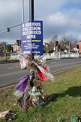 Roadside memorial and police notice at the site of a road traffic accident, Sheffield