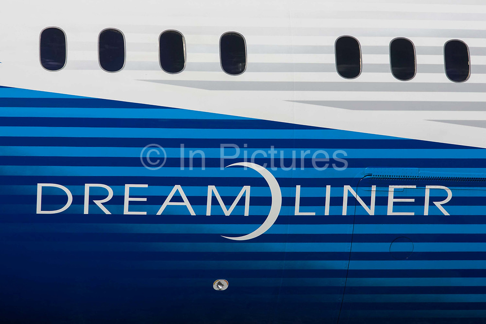 Detail of a Boeing 787-9 Dreamliner jet airliner fuselage at the Farnborough Air Show, England. The Boeing 787-9 Dreamliner is the second member of the super-efficient 787 family. Both the 787-8 and 787-9 bring the economics of large jets to the middle of the market, with 20 percent less fuel use and 20 percent fewer emissions.