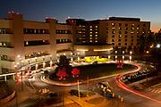 Duke University Hospital main entrance lit up with red lighting for National Heart Month