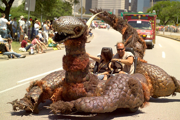 Stock photo of a man and woman riding in a car made into a large creature