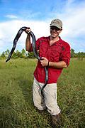Lance Paden holds an endangered indigo snake