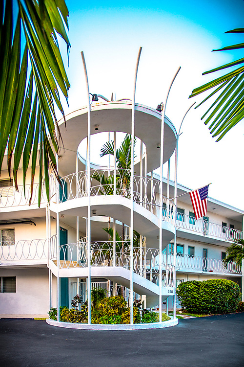 """The Bay Harbor Club apartments in the Miami Beach suburb of Bay Harbor Islands. This Space Age, Miami Modern (or MiMo) style from the 1950s and '60s is now being recognized as historically valuable and, in the view of some, worth preserving. This particular building, was the fictional home of the lead character in the television series """"Dexter."""" The architect was Charles McKirahan, and it was built in 1956."""