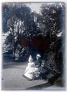 nanny with toddler in  garden setting France ca 1910s