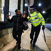 A policeman's threatening stance startles a passerby who was alleged to be heading home from work near St Thomas Hospital, central London on Sunday 7 June 2020. Anger against systemic levels of institutional racism has raged through the city, and worldwide; sparked by the death of George Floyd, who was killed in Minneapolis, US, by a policeman who restrained him with force on 25 May 2020. (Photo/ Vudi Xhymshiti)