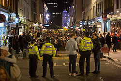 © Licensed to London News Pictures.  24/04/2021. London, UK. Police patrol as members of the public make the most of Saturday night out in Soho, central London as lockdown restriction were eased last week. Photo credit: Marcin Nowak/LNP